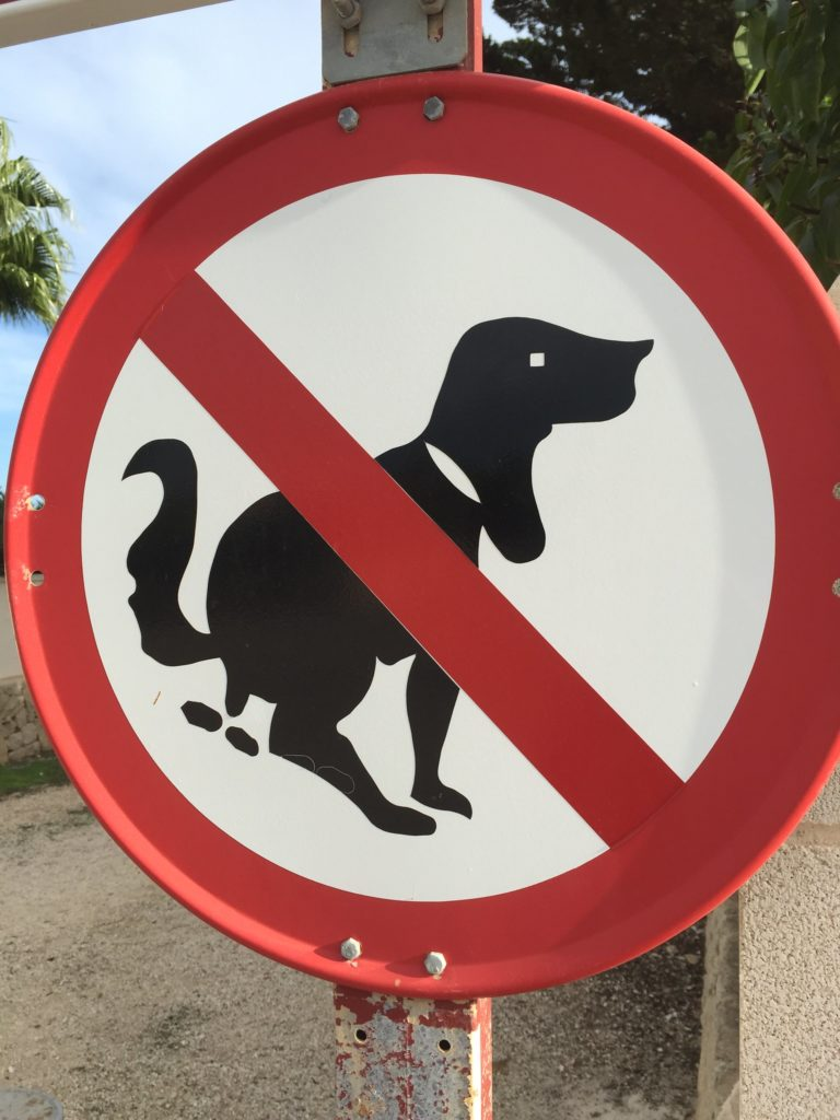 Pooping dog sign