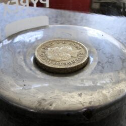 A pound coin floating in mercury