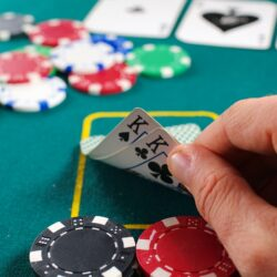Poker player discreetly checking his cards
