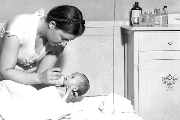 Student caring for practice baby at Cornell University